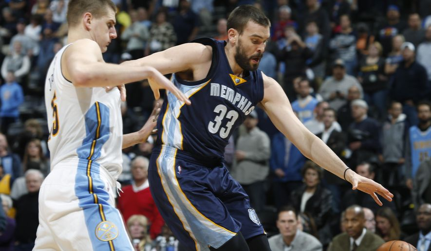 Memphis Grizzlies center Marc Gasol, right, of Spain, loses control of the ball while driving the lane against Denver Nuggets center Nikola Jokic, of Serbia, in the first half of an NBA basketball game, Thursday, Jan. 21, 2016, in Denver (AP Photo/David Zalubowski)