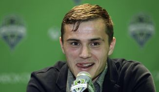 Jordan Morris speaks Thursday, Jan. 21, 2016, in Seattle after the MLS soccer Seattle Sounders FC announced his signing as a forward. Morris, who played for Stanford, was the Hermann Trophy winner in 2015 as the top college player in the country. (AP Photo/Ted S. Warren)