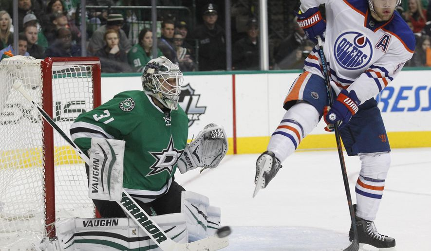 Edmonton Oilers left wing Taylor Hall (4) attempts to deflect the puck in front of Dallas Stars goalie Antti Niemi (31) during the second period of an NHL hockey game Thursday, Jan. 21, 2016, in Dallas. (AP Photo/Tim Sharp)
