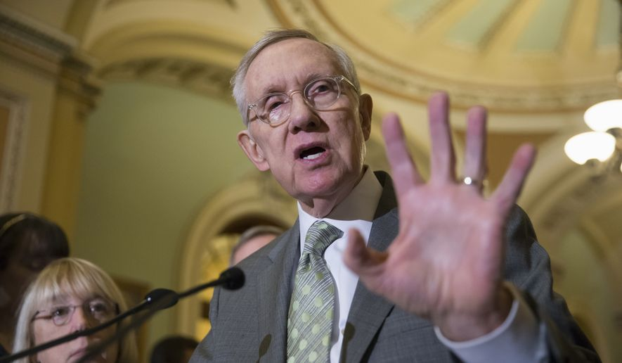 Senate Minority Leader Harry Reid of Nev., joined by Sen. Patty Murray, D-Wash., speaks with reporters on Capitol Hill in Washington, Wednesday, Jan. 20, 2016, before Democrats blocked legislation from the GOP-led House on a bill that would crack down on Syrian and Iraqi refugees entering America. (Associated Press) **FILE**