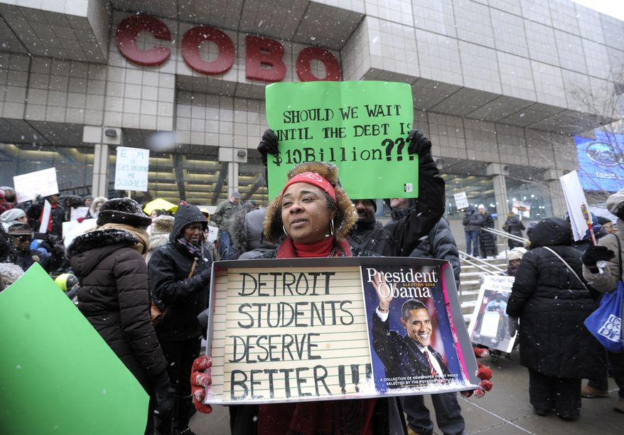 Western International High School teacher Debrah Baskin, 53, of Southfield, and other teachers from Detroit area schools protest outside the Cobo Center, in this Wednesday, Jan. 20, 2106, file photo, only hours before President Obama's visit to the auto show. (Todd McInturf/Detroit News via AP) ** FILE *