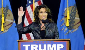 Former Republican vice presidential candidate Sarah Palin speaks to a crowd as she introduces Republican presidential candidate Donald Trump at a rally in Tulsa, Okla., Wednesday, Jan 20, 2016. (AP Photo/Brandi Simons)