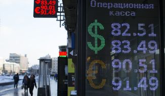 People walk past an exchange office screen showing the currency exchange rates of the Russian ruble, U.S. dollar and euro in Moscow, Russia, Thursday, Jan. 21, 2016. The Russian ruble has hit another historic low against the dollar as oil prices continue to slide due to a surplus of crude oil on world markets. (AP Photo/Alexander Zemlianichenko)