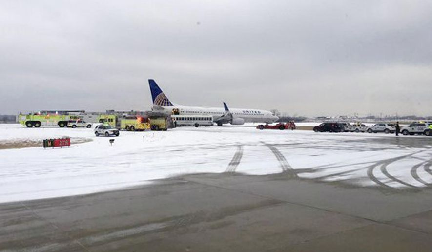 "This photo provided by @hypatiadotca shows a United Airlines flight from San Francisco that rolled all the way to the end of a runway when it landed at Chicago's O'Hare International Airport Friday, Jan. 22, 2016 in Chicago. Passenger Leigh Honeywell told The Associated Press the landing seemed normal until the pilot announced the plane was ""off the end of the runway."" No injuries were reported. (@hypatiadotca via AP)"