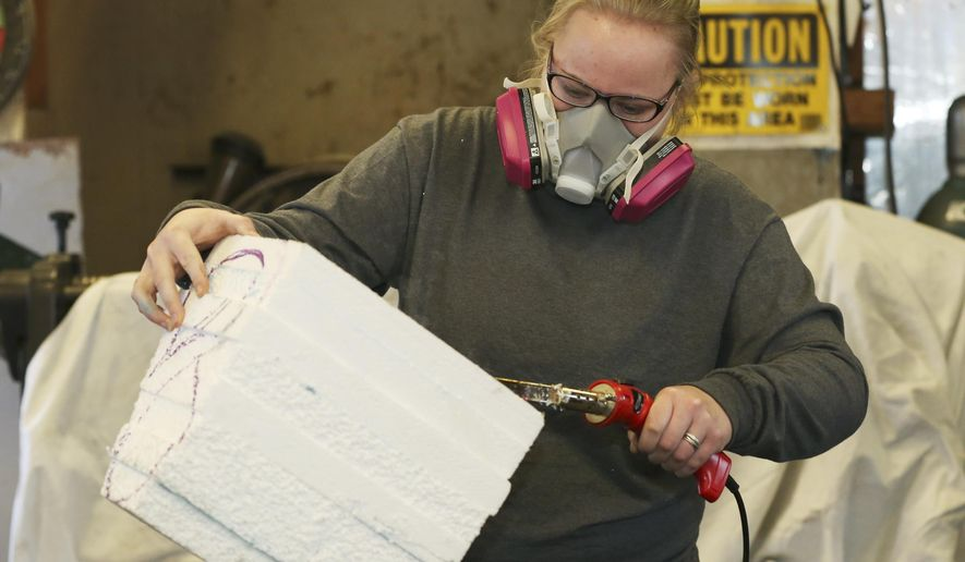 In this photo taken on Jan. 14, 2016, sophomore elementary education major Ashley Gocke carves a piece of Styrofoam during the Implied Motion in Art J-Term class at Hastings College in Hastings, Neb. For the last 50 years, Hastings College students and professors have taken three weeks off from the regular classes to explore other things through internships or by leaving the country.   (Laura Beahm /The Hastings Tribune via AP) MANDATORY CREDIT
