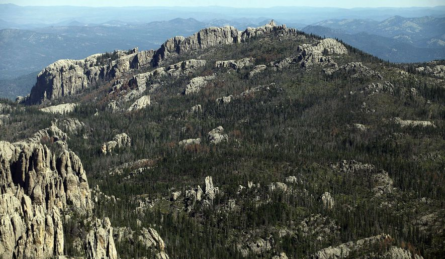 FILE - This Aug. 14, 2014 aerial file photo shows Harney Peak southwest of Hill City, S.D. On Friday, Jan. 22, 2016, a state House committee approved a measure that would limit the autonomy of a state board thrust into the spotlight for considering a recommendation to rename Harney Peak. (Chris Huber/Rapid City Journal via AP, File)  TV OUT