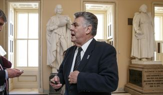 Rep. Peter King, R-N.Y., stands outside the House chamber on Capitol Hill in Washington, in this Feb. 27, 2015, file photo. (AP Photo/J. Scott Applewhite, File)