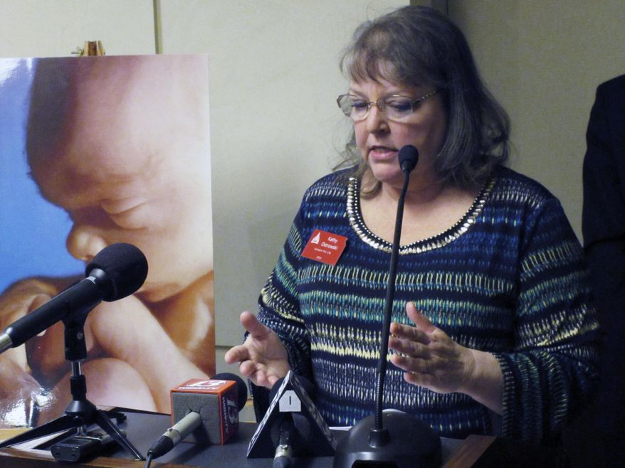Kathy Ostrowski, lobbyist and legislative director for the anti-abortion group Kansans for Life, criticizes a state Court of Appeals ruling on abortion, Friday, Jan. 22, 2016, at the Statehouse in Topeka, Kan. The ruling blocked enforcement of the state's first-in-the-nation ban on a common second-trimester procedure. (AP Photo/John Hanna).