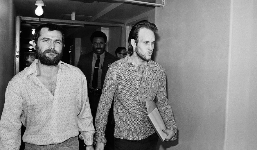 "FILE - This Dec. 22, 1970 file photo shows Charles Manson followers Bruce Davis, left, and Steve Grogan leaving court after a hearing in Los Angeles. Gov. Jerry Brown has rejected parole for Davis a follower of cult leader Charles Manson 46 years after a series of bloody murders rocked Southern California, Friday, Jan. 22, 2016. Bruce Davis was convicted of the 1969 slayings of musician Gary Hinman and stuntman Donald ""Shorty"" Shea. He was not involved in the more notorious killings of actress Sharon Tate and six others.(AP Photo/Harold Filan, File)"