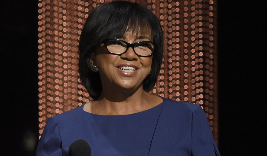 In this Jan. 14, 2016 file photo, Academy President Cheryl Boone Isaacs announces the Academy Awards nominations at the 88th Academy Awards nomination ceremony in Beverly Hills, Calif.  The film academy is pledging to double the number of female and minority members by 2020, and will immediately diversify its leadership by adding three new seats to its board of governors. Isaacs announced the changes Friday, Jan. 22, following a weeklong storm of criticism and calls for an Oscar boycott after academy members nominated an all-white slate of actors for the second year in a row.  (Chris Pizzello/Invision/AP, File)