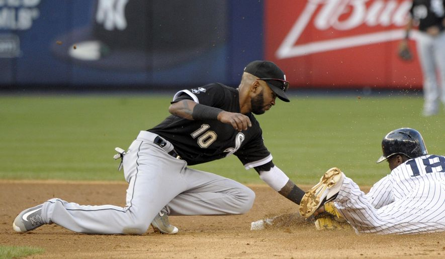 FILE - In this Sept. 26, 2015, file photo, Chicago White Sox shortstop Alexei Ramirez, left, tags out New York Yankees' Didi Gregorius who was attempting to steal second base during the fifth inning of a baseball game in New York. Ramirez and the San Diego Padres have finalized a $4 million, one-year contract under the deal announced Friday, Jan. 22, 2016. (AP Photo/Bill Kostroun, File)