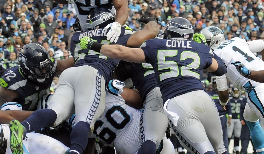 FILE - In this Sunday, Jan. 17, 2016, file photo, Carolina Panthers running back Jonathan Stewart (28) leaps over the Seattle Seahawks defensive line to score a touchdown during the first half of an NFL divisional playoff football game in Charlotte, N.C. The Panthers haven't missed a beat since releasing their all-time leading rusher Deangelo Williams in the offseason in large part because of the way Jonathan Stewart has stepped up. (AP Photo/Mike McCarn, File)