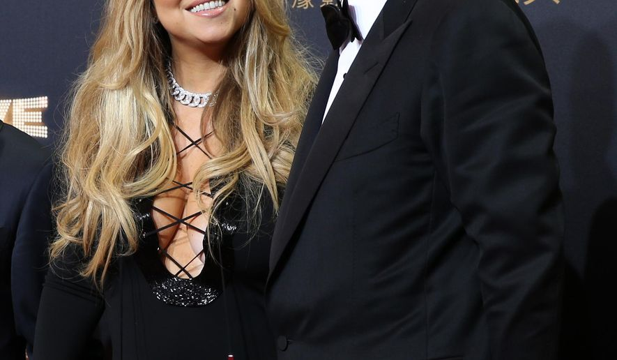 FILE - In this Oct. 27, 2015 file photo, singer Mariah Carey, left, and Australian businessman James Packer attend the opening ceremony for the Studio City project in Macau. The singer's representative said Friday that Carey and Packer got engaged in New York City on Thursday, Jan. 21, 2016. (AP Photo/Kin Cheung, File)