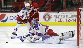 New York Rangers goalie Henrik Lundqvist (30), of Sweden, reaches to block as Rangers' Dan Boyle (22) defends Carolina Hurricanes' Victor Rask, of Sweden, during the second period of an NHL hockey game in Raleigh, N.C., Friday, Jan. 22, 2016. (AP Photo/Gerry Broome)