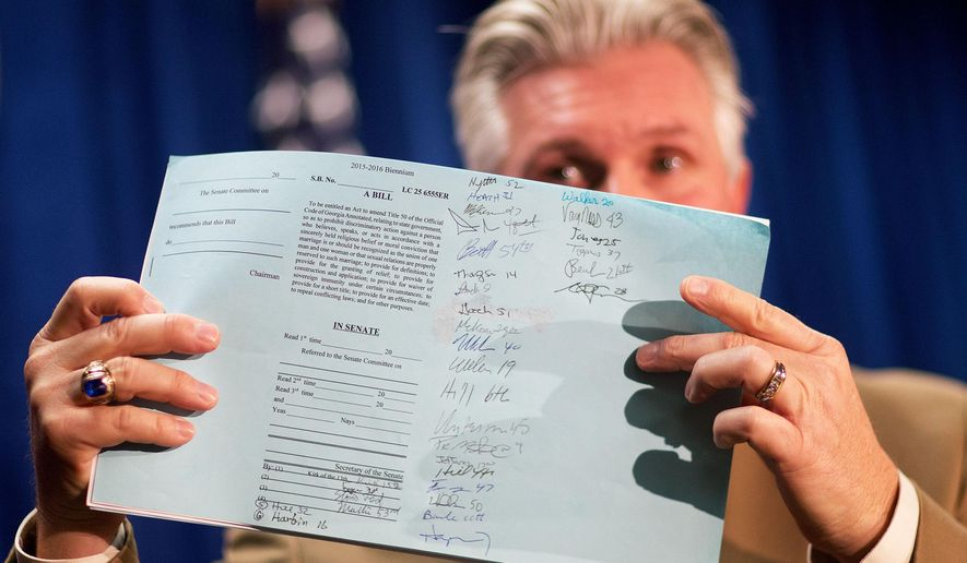 State Sen. Greg Kirk, R-Americus, shows signatures of fellow lawmakers on a bill he plans to introduce that provides religious exemptions in the wake of last year's U.S. Supreme Court decision legalizing gay marriage Thursday, Jan. 21, 2016, in Atlanta. Kirk says religious adoption agencies, schools and other nonprofits should be able to refuse service to same-sex couples. But Kirk says government employees still would have to carry out duties of their job, including clerks issuing marriage licenses. (AP Photo/David Goldman)
