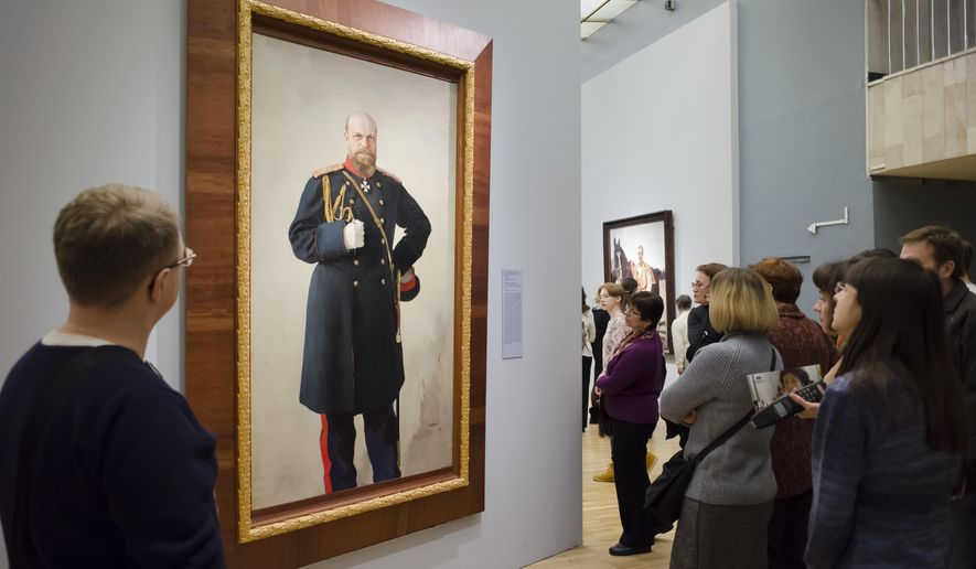 In this photo taken on Sunday, Jan. 10, 2016, visitors look at a painting by Valentin Serov at the exhibition of his works in the Tretyakov Gallery in Moscow, Russia. The 19th-century Russian impressionist Valentin Serov is best known for his expressive still-life paintings and portraits. A collection of his works are on display at the Tretyakov Gallery in Moscow, drawing huge crowds of hopeful museum goers. (AP Photo/Alexander Zemlianichenko)