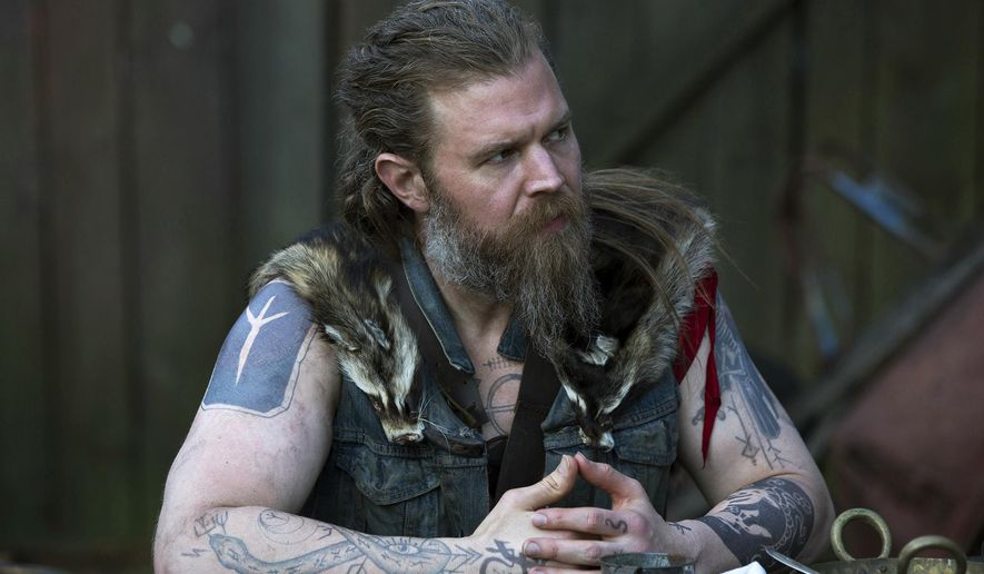 """This image released by WGN America shows Ryan Hurst as Lil Fosterin a scene from """"Outsiders,"""" premiering on Tuesday, Jan. 26 at 9 p.m. ET. (Eric Liebowitz/WGN America via AP)"""