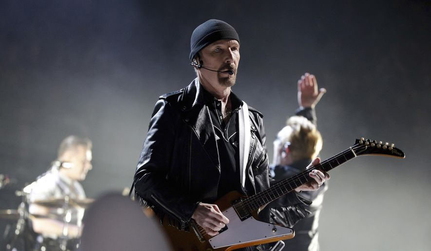 In this  Sunday, Dec. 6, 2015 file photo, The Edge of U2 performs on stage during a concert, in Paris, Sunday, Dec. 6, 2015. (AP Photo/Thibault Camus, File)