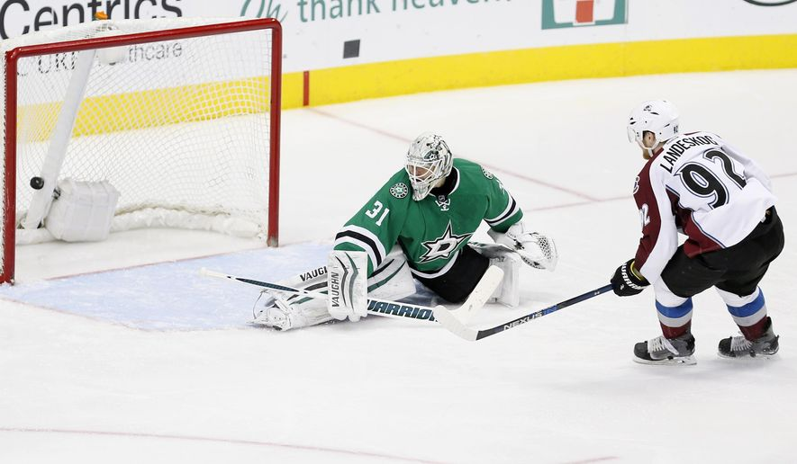 Colorado Avalanche forward Gabriel Landeskog (92) scores a short-handed goal against Dallas Stars goalie Antti Niemi (31) during the second period of an NHL hockey game Saturday, Jan. 23, 2016, in Dallas. (AP Photo/Brandon Wade)