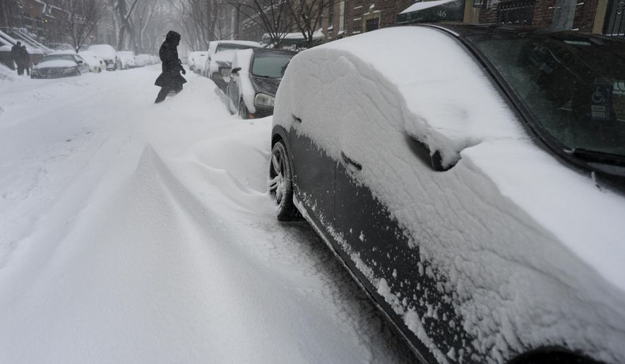 Drifts form near cars in the Upper West Side as heavy snow falls in New York Saturday, Jan. 23, 2016, as a large winter storm rolls up the East Coast. (AP Photo/Craig Ruttle)