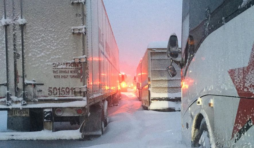 In this photo provided by Dave Saba, traffic is at a standstill on the Pennsylvania Turnpike near Somerset, Pa., Saturday, Jan. 23, 2016.  The Duquesne men's basketball team and Temple University's women's gymnastics team are stuck on the Turnpike due to a treacherous weather conditions.   A mammoth winter storm crawled up the U.S. East Coast Saturday, making roads impassable, shutting down mass transit, and bringing Washington and New York City to a standstill. (Dave Saba via AP)