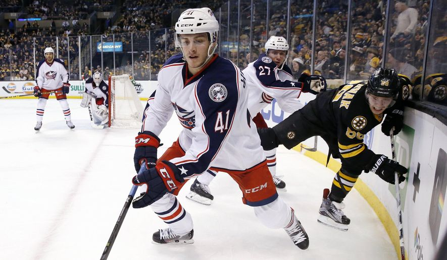Columbus Blue Jackets' Ryan Murray (27) checks Boston Bruins' David Pastrnak (88) behind Blue Jackets' Alexander Wennberg (41) during the second period of an NHL hockey game in Boston, Saturday, Jan. 23, 2016. (AP Photo/Michael Dwyer)