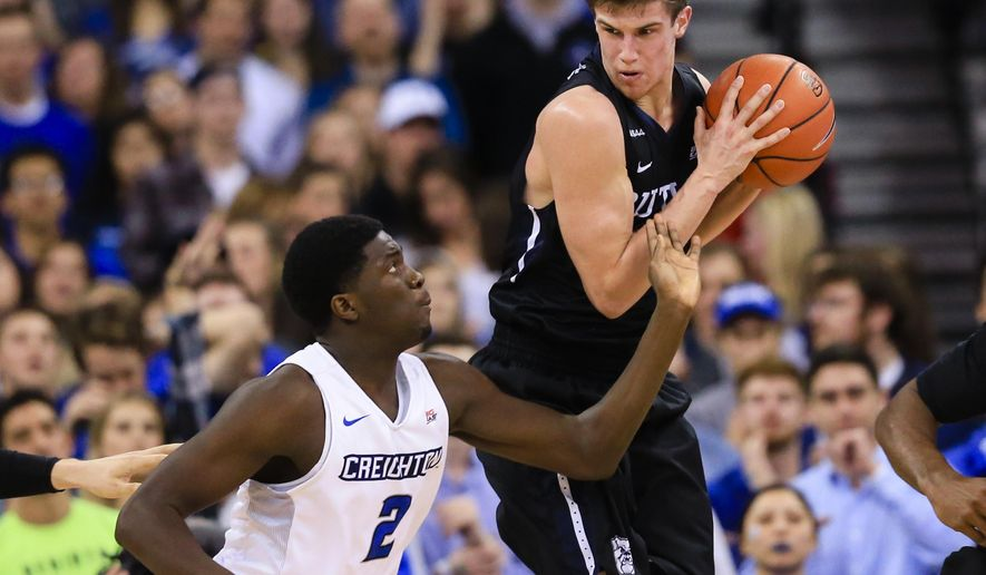 Butler's Kellen Dunham (24) grabs a rebound over Creighton's Khyri Thomas (2) during the first half of an NCAA college basketball game in Omaha, Neb., Saturday, Jan. 23, 2016. (AP Photo/Nati Harnik)