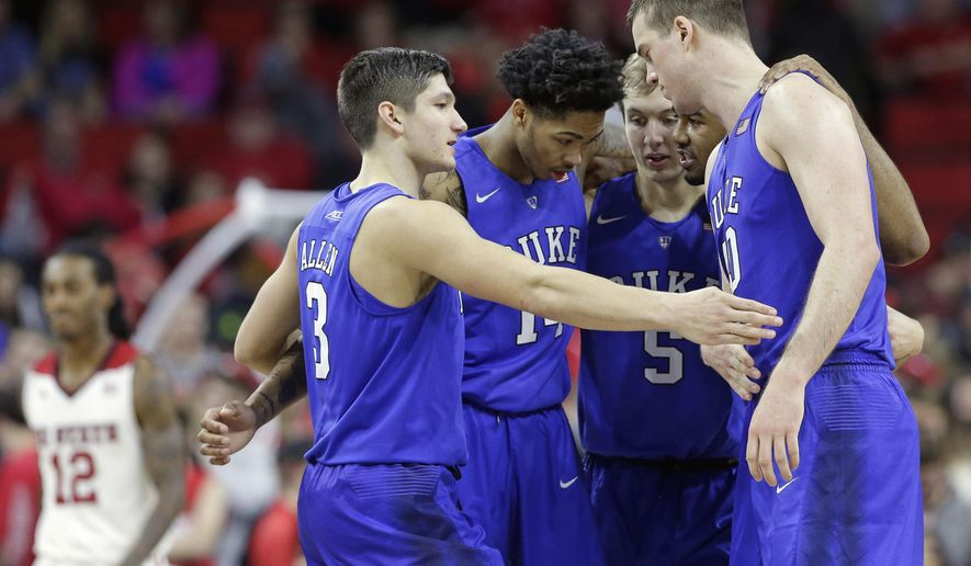 Duke's Grayson Allen (3), Brandon Ingram (14), Luke Kennard (5), Matt Jones and Marshall Plumlee come together following a play during the second half of an NCAA college basketball game against against North Carolina State in Raleigh, N.C., Saturday, Jan. 23, 2016. Duke won 88-78. (AP Photo/Gerry Broome)