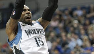 Minnesota Timberwolves forward Shabazz Muhammad (15) dunks during the first half of an NBA basketball game, Saturday, Jan. 23, 2016, in Minneapolis. (AP Photo/Paul Battaglia)