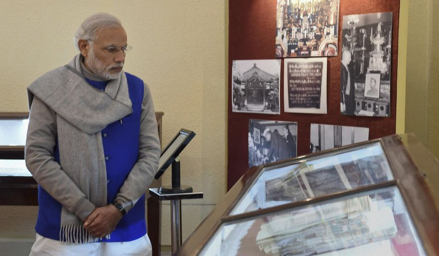Indian Prime Minister Narendra Modi looks at documents displayed at the National Archives of India (NAI) where he released the digital copies of 100 declassified files related to Netaji Subhash Chandra Bose in New Delhi, India, Saturday, Jan. 23, 2016. India's government on Saturday started declassifying secret files to settle questions over the death of Subhash Chandra Bose, a Congress party leader who formed a national army to fight British colonial rulers with the help of the Japanese in the 1940s. (Subhav Shukla/Press Trust of India via AP) INDIA OUT, MANDATORY CREDIT, NO ARCHIVE
