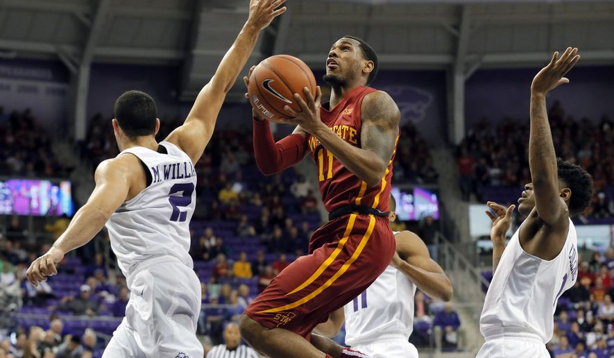 TCU guard Michael Williams (2) defends as Iowa State guard Monte Morris (11) leaps to the basket for a shot in the first half of an NCAA college basketball game, Saturday, Jan. 23, 2016, in Fort Worth, Texas. (AP Photo/Tony Gutierrez)