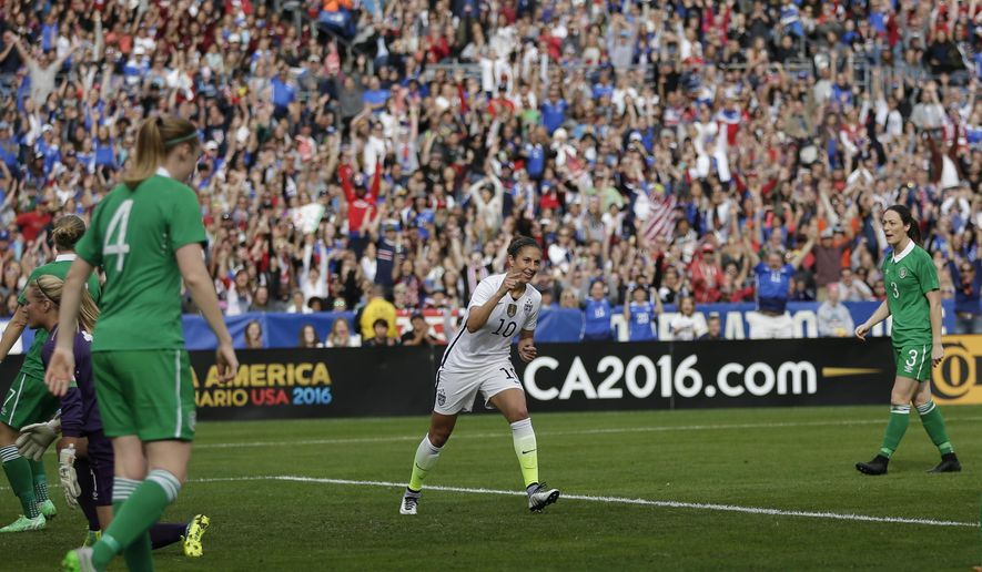 The United States' Carli Lloyd, center, reacts after scoring against Ireland during the first half in a women's international friendly soccer game Saturday, Jan. 23, 2016, in San Diego. (AP Photo/Gregory Bull)