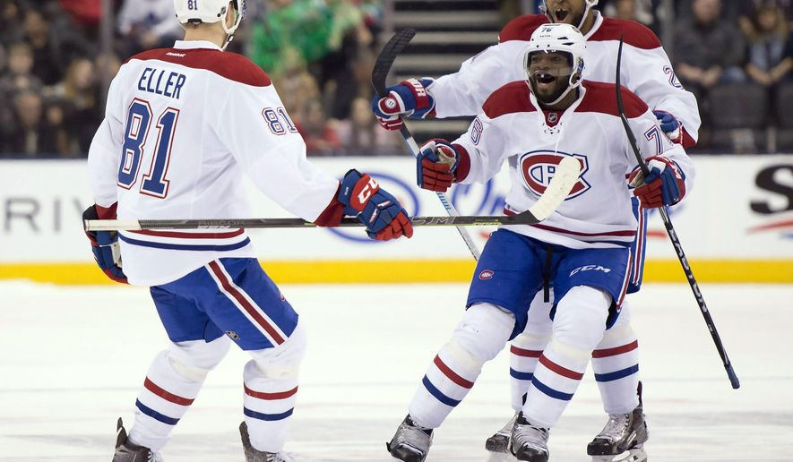 Montreal Canadiens center Lars Eller (81) is congratulated by teammates P.K. Subban and Devante Smith-Pelley, rear, after scoring in overtime against the Toronto Maple Leafs during an NHL hockey game in Toronto on Saturday, Jan. 23, 2016. (Frank Gunn/The Canadian Press via AP)