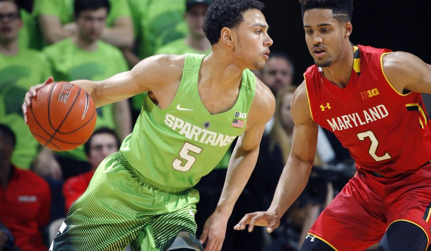 Michigan State's Bryn Forbes, left, drives against Maryland's Melo Trimble (2) during the first half of an NCAA college basketball game, Saturday, Jan. 23, 2016, in East Lansing, Mich. (AP Photo/Al Goldis)