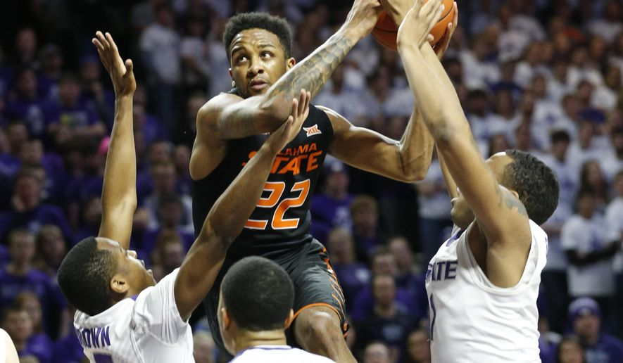Oklahoma State guard Jeff Newberry (22) drives for the basket against Kansas State during an NCAA college basketball game Saturday, Jan. 23, 2016, in Manhattan, Kan. (Bo Rader /The Wichita Eagle via AP) LOCAL TELEVISION OUT; MAGS OUT; LOCAL RADIO OUT; LOCAL INTERNET OUT; MANDATORY CREDIT