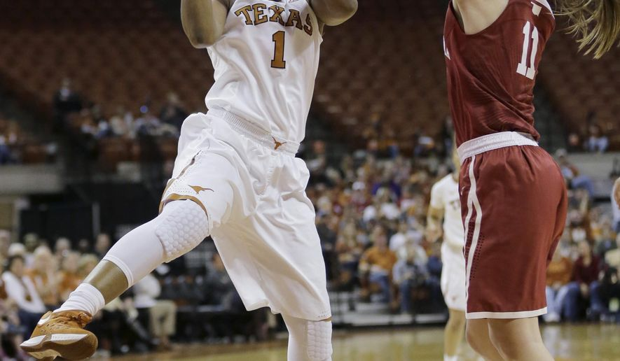 Texas guard Empress Davenport (1) and Oklahoma guard Derica Wyatt (11) reach for a rebound during the first half of an NCAA college basketball game, Saturday, Jan. 23, 2016, in Austin, Texas. (AP Photo/Eric Gay)