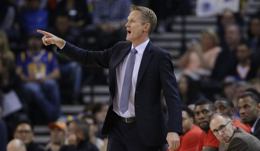 Golden State Warriors coach Steve Kerr talks to his team from the sideline during the first half of the Warriors' NBA basketball game against the Indiana Pacers on Friday, Jan. 22, 2016, in Oakland, Calif. (AP Photo/Marcio Jose Sanchez)