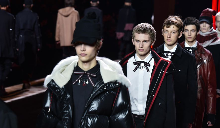 Models wear creations as part of Dior men's Fall-Winter 2016-2017 fashion collection, presented in Paris, Saturday, Jan. 23, 2016. (AP Photo/Zacharie Scheurer)