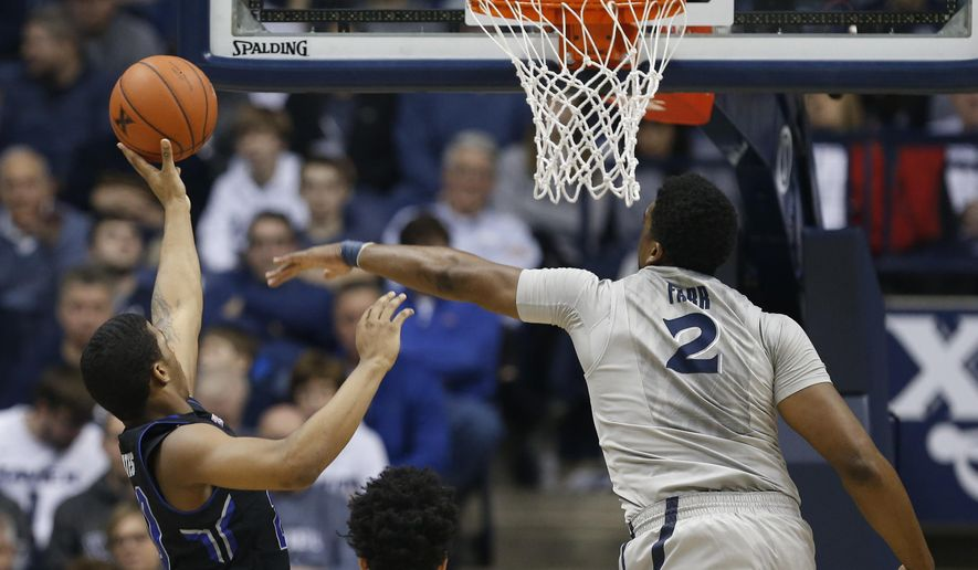 Seton Hall forward Desi Rodriguez (20) gets a shot off against Xavier forward James Farr (2) during the first half of an NCAA college basketball game, Saturday, Jan. 23, 2016, in Cincinnati. (AP Photo/Gary Landers)