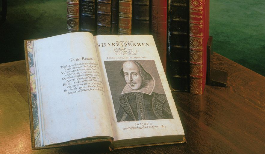 """This undated photo provided by the Folger Shakespeare Library in Washington shows a """"First Folio"""" book of William Shakespeare. The book was published in 1623, seven years after the playwright's death, and includes 36 of his plays. Researchers believe that no more than 750 """"First Folio"""" were printed and only 233 survive — one of them will be on display at the National Music Museum in Vermillion, S.D., in March 2016. (Folger Shakespeare Library via AP) **FILE**"""