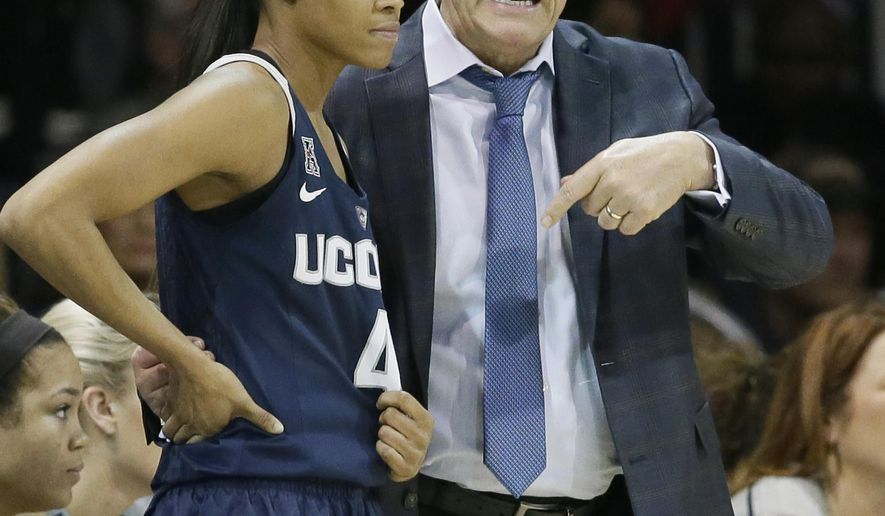 Connecticut head coach Geno Auriemma, right, speaks with Moriah Jefferson (4) during the first half of an NCAA college basketball game against SMU Saturday, Jan. 23, 2016, in Dallas. (AP Photo/LM Otero)