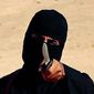 """Mohammed Emwazi, known as """"Jihadi John,"""" appeared in several videos depicting the beheadings of Western hostages. The Islamic State group is acknowledging the death of the masked militant and published a """"eulogizing profile"""" of him last week. (SITE Intelligence Group via Associated Press)"""