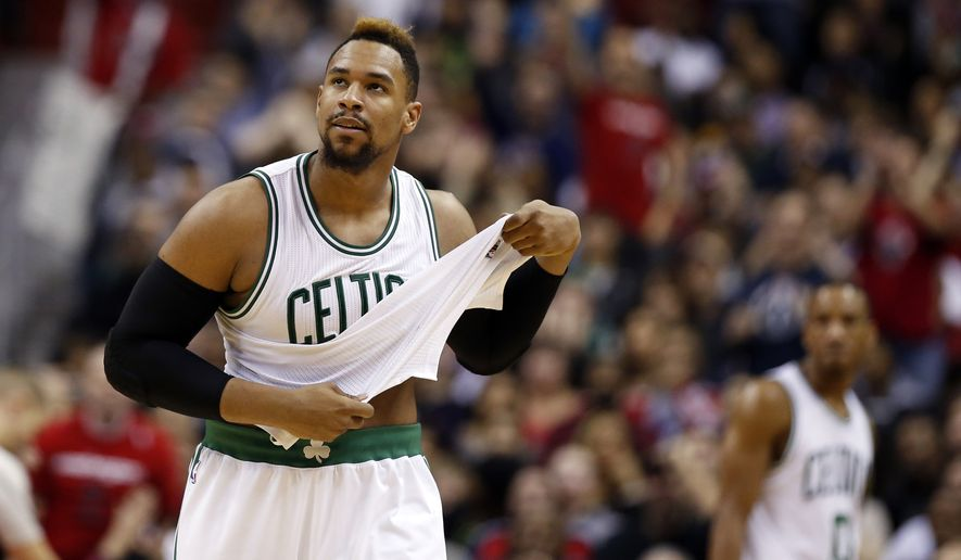 Boston Celtics center Jared Sullinger (7) heads to bench after he fouled out in the second half of an NBA basketball game against the Washington Wizards, Saturday, Jan. 16, 2016, in Washington. The Celtics won 119-117. (AP Photo/Alex Brandon)