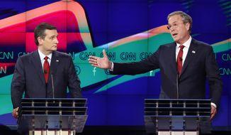 In this Dec. 15, 2015, file photo, former Florida Gov. Jeb Bush, right, makes a point as Sen. Ted Cruz, R-Texas, listens on during the Republican presidential debate in Las Vegas. (AP Photo/John Locher, File)