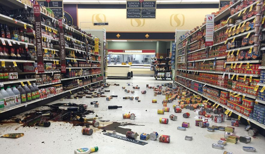 In this photo provided by Vincent Nusunginya, items fallen from the shelves litter the aisles inside a Safeway grocery store following a magnitude 6.8 earthquake on the Kenai Peninsula on Sunday, Jan. 24, 2016, in south-central Alaska. (Vincent Nusunginya via the AP)