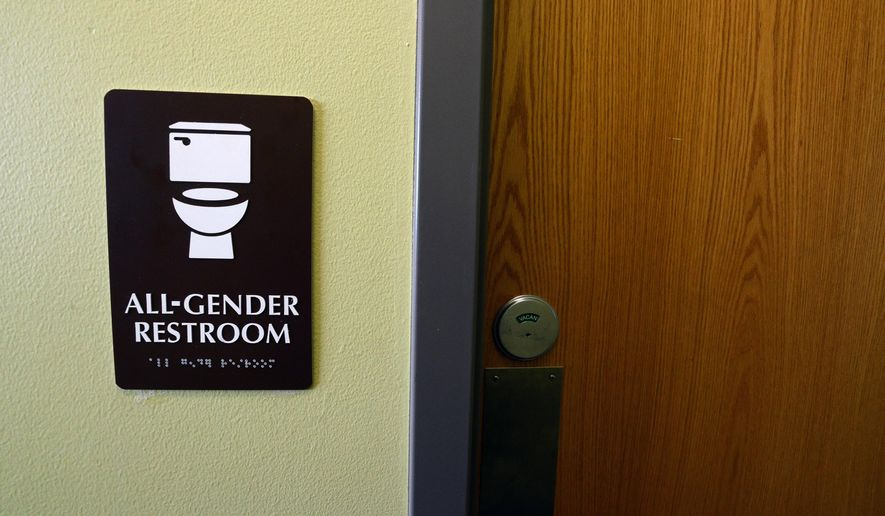 "In this photo taken on Friday, Jan. 15, 2016, a sign for an all-gender bathroom is displayed at the Naropa University Nalanda Campus in Boulder, Colo. As part of a broad reexamination of restrooms on its campuses, Naropa University has created two ""all gender"" bathrooms on the second floor of its Nalanda campus at 63rd Street and Arapahoe Avenue. (Paul Aiken/Daily Camera via AP) NO SALES; MANDATORY CREDIT"