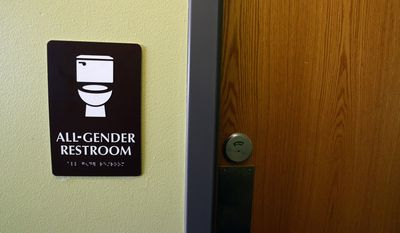 """In this photo taken on Friday, Jan. 15, 2016, a sign for an all-gender bathroom is displayed at the Naropa University Nalanda Campus in Boulder, Colo. As part of a broad reexamination of restrooms on its campuses, Naropa University has created two """"all gender"""" bathrooms on the second floor of its Nalanda campus at 63rd Street and Arapahoe Avenue. (Paul Aiken/Daily Camera via AP) NO SALES; MANDATORY CREDIT"""