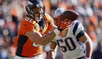 Denver Broncos tight end Owen Daniels (81) catches a 21-yard touchdown pass from quarterback Peyton Manning during the first half the NFL football AFC Championship game between the Denver Broncos and the New England Patriots, Sunday, Jan. 24, 2016, in Denver. (AP Photo/David Zalubowski)
