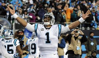 Carolina Panthers' Cam Newton celebrates Ted Ginn's run for a touchdown during the first half the NFL football NFC Championship game against the Arizona Cardinals, Sunday, Jan. 24, 2016, in Charlotte, N.C. (AP Photo/Mike McCarn)
