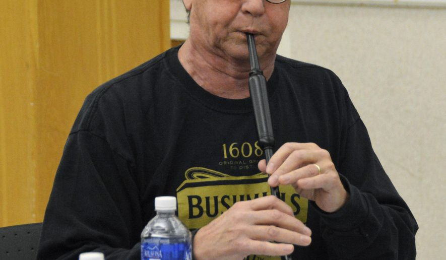 In this Jan. 9, 2016 photo, Tom Parliman, pipe major for Dakota District Pipes & Drums, plays a practice chanter during a group rehearsal at the VA Hospital in Sioux Falls, S.D. (AP Photo/Dirk Lammers)